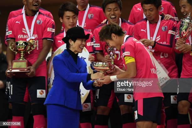 Captain Yoichiro Kakitani of Cerezo Osaka receives the trophy from Princess Hisako Takamado during the medal ceremony after the 97th All Japan...