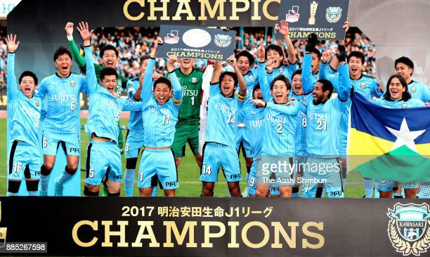 Captain Yu Kobayashi and Kengo Nakamura of Kawasaki Frontale lift the trophy panel as players celebrate the J1 Champions after the JLeague J1 match...