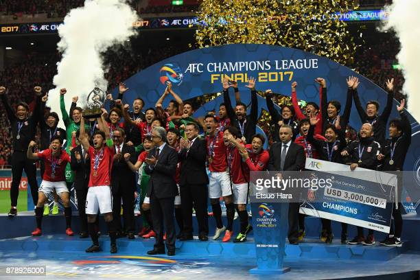 Captain Yuki Abe of Urawa Red Diamonds lifts the AFC Champions League trophy at the award ceremony during the AFC Champions League Final second leg...
