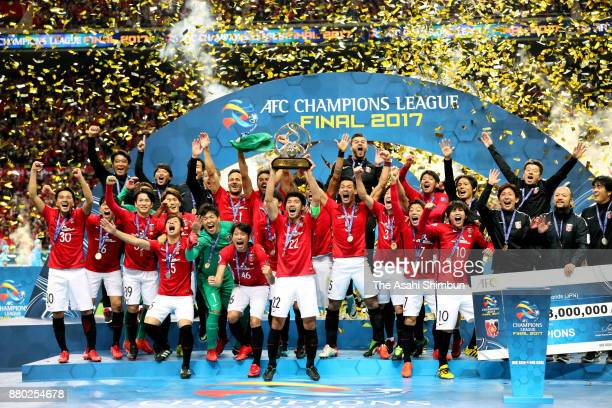Captain Yuki Abe of Urawa Red Diamonds lifts the trophy at the award ceremony after the AFC Champions League Final second leg match between Urawa Red...