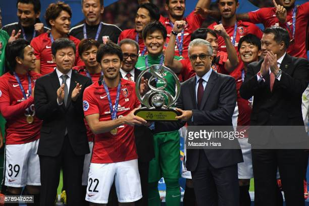 Captain Yuki Abe of Urawa Red Diamonds receives the AFC Champions League Trophy by the Asian Football Confederation President Shaikh Salman bin...