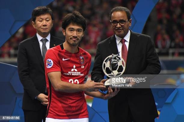 Captain Yuki Abe of Urawa Red Diamonds receives the Fair Play Award trophy at the award ceremony after the AFC Champions League Final second leg...