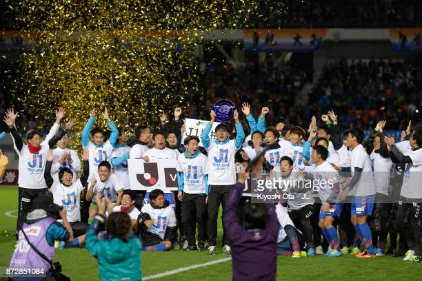 Captain Yusuke Murakami and VVaren Nagasaki players celebrate after their team's promotion to the J1 after their 31 victory in the JLeague J2 match...