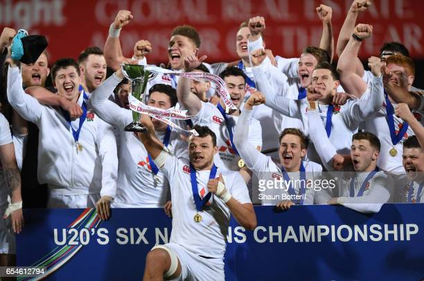 Captain Zach Mercer of England and his players celebrate with the trophy after wining the Grand Slam during the U20 Six Nations match between Ireland...