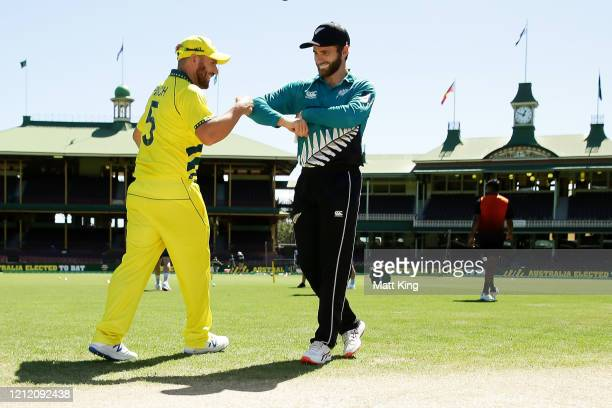 Captains Aaron Finch of Australia and Kane Williamson of New Zealand touch elbows after the coin toss during game one of the One Day International...