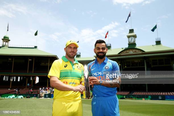 Captains Aaron Finch of Australia and Virat Kohli of India pose with the ODI series trophy during the Australia v India ODI Series Captains Trophy...