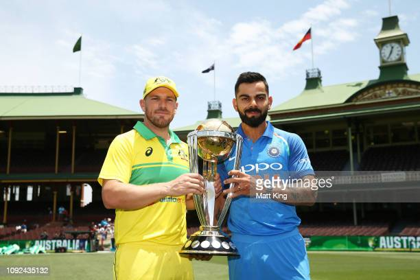 Captains Aaron Finch of Australia and Virat Kohli of India pose with ICC Cricket World Cup trophy during the Australia v India ODI Series Captains...