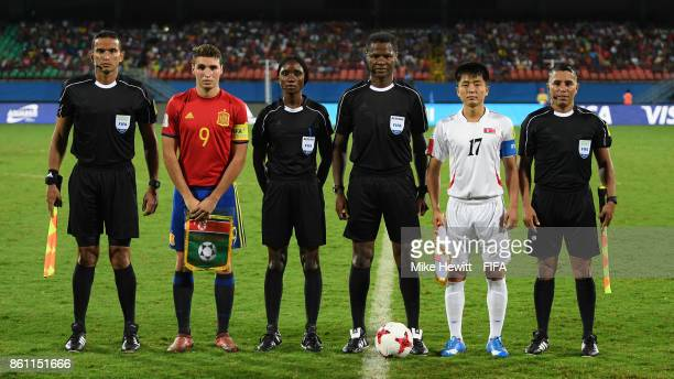 Captains Abel Ruiz of Spain and Yun Min of Korea DPR pose for a photo with the match officials ahead of the FIFA U17 World Cup India 2017 group D...