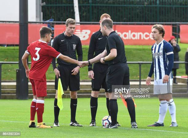 Captains Adam Lewis of Liverpool and Jack McCourt of West Bromwich Albion with referee Nikolas Storey and his assistants Matthew Young and Tom...