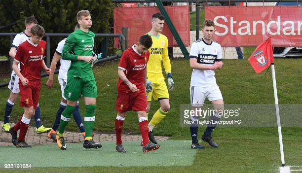 Captains Adam Lewis of Liverpool and Nathan Dale of Middlesbrough lead their teams onto the pitch at the start of the Liverpool v Middlesbrough U18...