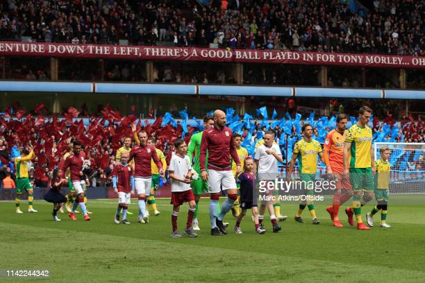 Captain's Alan Hutton of Aston Villa and Christoph Zimmermann of Norwich City lead out the teams during the Sky Bet Championship match between Aston...