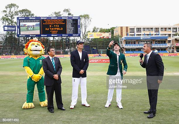 Captains Alastair Cook of England and AB de Villiers of South Africa perform the coin toss which South Africa won and chose to bat during day one of...