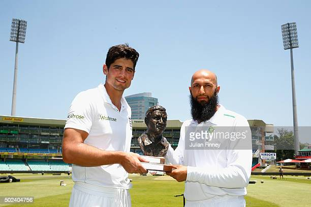 Captains Alastair Cook of England and Hashim Amla of South Africa pose with the Basil D'Oliveira trophy after England nets and training session at...