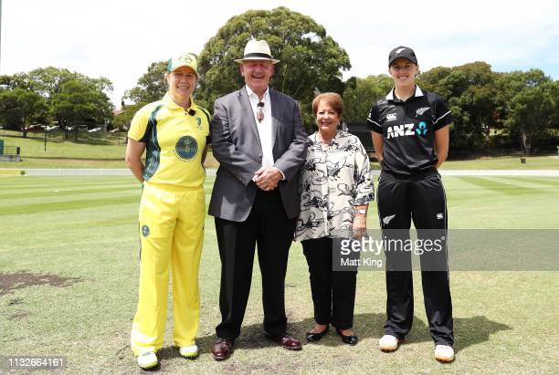 Captains Alex Blackwell of the GovernorGeneral's XI and Amy Satterthwaite of New Zealand pose with the GovernorGeneral of Australia Peter Cosgrove...