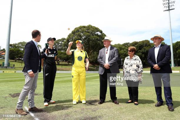 Captains Alex Blackwell of the GovernorGeneral's XI and Amy Satterthwaite of New Zealand take part in the coin toss next to the GovernorGeneral of...