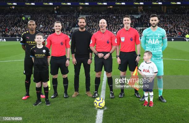 Captains and officials line up before the coin toss during the Premier League match between Tottenham Hotspur and Manchester City at Tottenham...