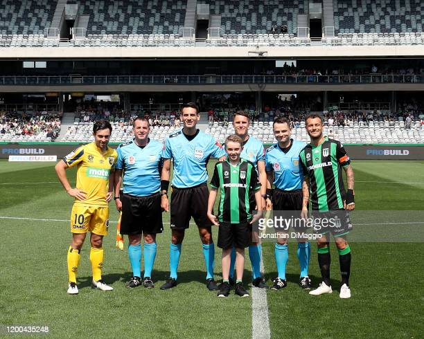 Captains and Referees pose for a photo during the round 15 ALeague match between Western United and the Central Coast Mariners at GMHBA Stadium on...