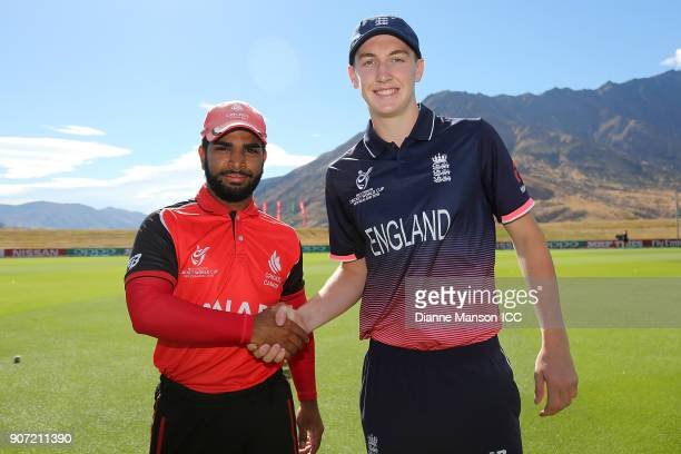 Captains Arslan Khan of Canada and Harry Brook of England pose for a photo ahead of the ICC U19 Cricket World Cup match between England and Canada at...