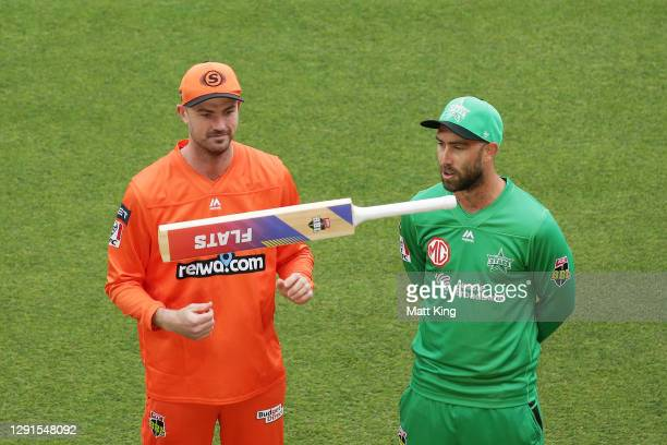 Captains Ashton Turner of the Scorchers and Glenn Maxwell of the Stars take part in the bat flip during the Big Bash League match between the Perth...
