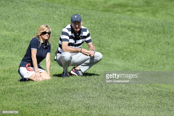 Captain's assistant Jim Furyk of the US Team and his wife Tabitha Furyk look on during Thursday foursome matches of the Presidents Cup at Liberty...