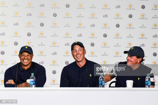 Captain's Assistant Tiger Woods Matt Kuchar and Phil Mickelson of the US Team smile during a press conference following the team's victory after...