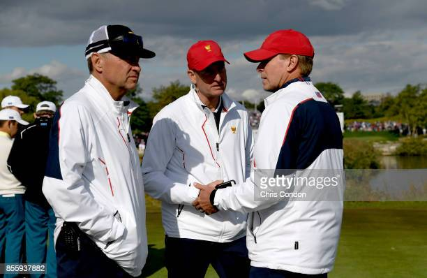 Captains Assistants Davis Love III and Jim Furyk talk with Steve Stricker, Captain of the U.S. Team, during the Saturday morning foursomes matches...