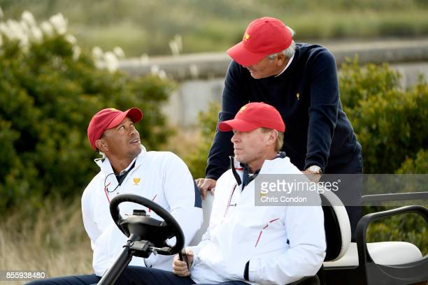 Captain's Assistants Tiger Woods and Fred Couples talk with Steve Stricker Captain of the US Team during the Saturday morning foursomes matches...