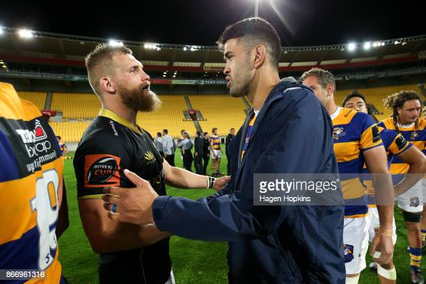 Captains Brad Shields of Wellington and Keepa Mewett of Bay of Plenty shake hands after the Mitre 10 Cup Championship Final match between Wellington...