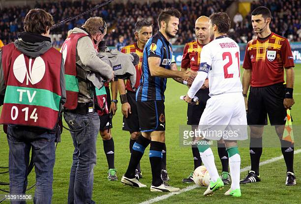 Captains Carl Hoefkens of Club Brugge KV shakes hands with Briguel of CS Maritimo prior to kickoff in the UEFA Europa League group stage match...