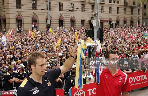 Captains Chris Judd of the West Coast Eagles and Leo Barry of the Sydney Swans hold the premiership trophy before thousands of fans during the AFL...