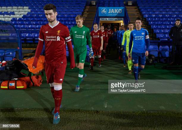 Captains Corey Whelan of Liverpool and Dirk Abels of PSV Eindhoven lead their teams to the pitch before the Liverpool v PSV Eindhoven Premier League...