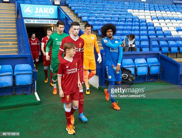 Captains Corey Whelan of Liverpool and Hamza Choudhury of Leicester City make their way from the tunnel before the Liverpool v Leicester City PL2...