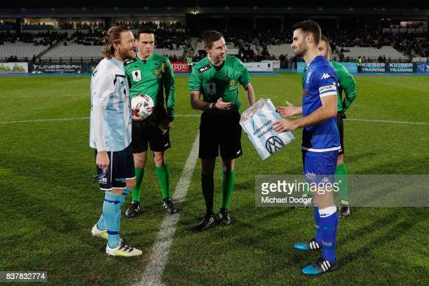 Captains Daryl Platten of Sorrento and Brad Norton of South Melbourne greet each other during the FFA Cup round of 16 match between between South...