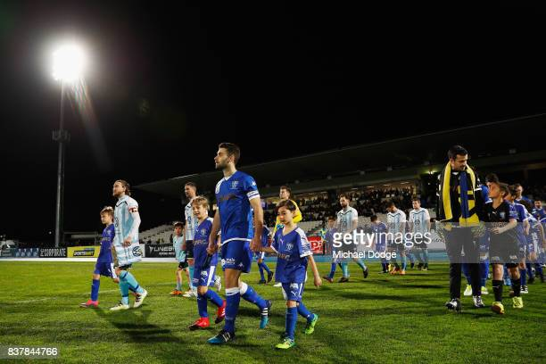 Captains Daryl Platten of Sorrento and Brad Norton of South Melbourne walk out during the FFA Cup round of 16 match between between South Melbourne...