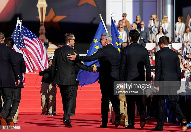 Captains Davis Love III of the United States and Darren Clarke of Europe shake hands during the 2016 Ryder Cup Opening Ceremony at Hazeltine National...