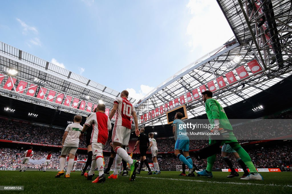 Captains, Davy Klaassen of Ajax and Dirk Kuyt of Feyenoord Rotterdam walk out to play the Dutch Eredivisie match between Ajax Amsterdam and Feyenoord at Amsterdam ArenA on April 2, 2017 in Amsterdam, Netherlands.