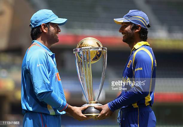 Captains MS Dhoni of India and Kumar Sangakkara of Sri Lanka pose with the ICC World Cup during the India nets session at the Wankhede Stadium on...