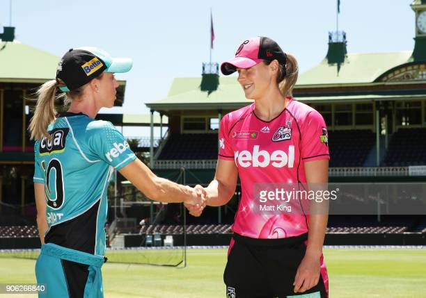 Captains Ellyse Perry of the Sixers and Kirby Short of the Heat shake hands after the coin toss during the Women's Big Bash League match between the...
