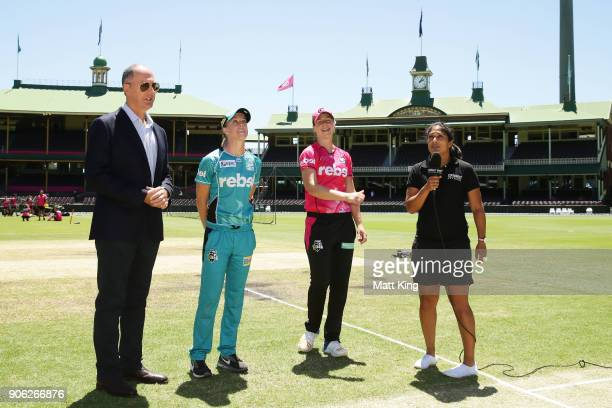 Captains Ellyse Perry of the Sixers and Kirby Short of the Heat take part in the coin toss during the Women's Big Bash League match between the...