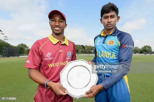 Captains Emmanuel Stewart of the West Indies and Kamindu Mendis of Sri Lanka pose with the trophy prior to the ICC U19 Cricket World Cup Plate Final...