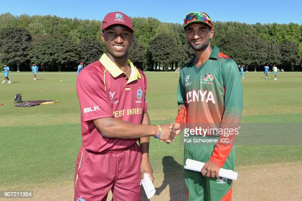 Captains Emmanuel Stewart of the West Indies and Sachin Bhudia of Kenya shake hands prior to the ICC U19 Cricket World Cup match between the West...