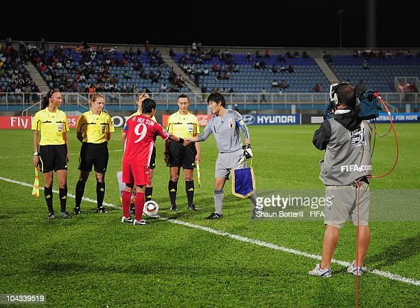 Captains Eri Hirao of Japan and O Hui Sun of North Korea meet before the FIFA U17 Women's World Cup Semi Final match between North Korea and Japan at...