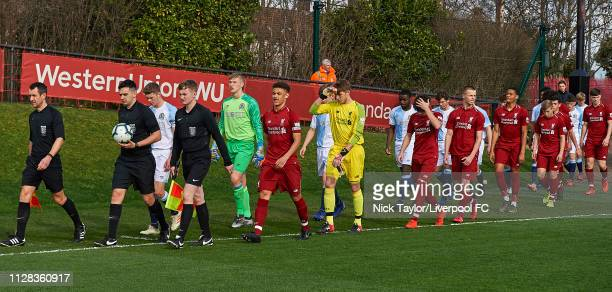 Captains Fidel O'Rourke of Liverpool and Isaac Whitehall of Blackburn Rovers lead their teams onto the pitch at the start of the U18 Premier League...