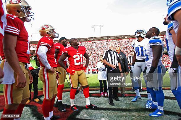 Captains for the San Francisco 49ers and Detroit Lions stands at center field for the coin toss prior to the game at Candlestick Park on September 16...