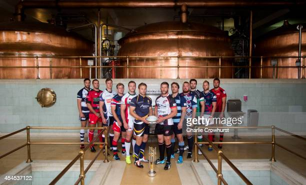 Captains from the championship teams pose for a photo during the 2014/15 Greene King IPA Championship Captains photocall at Greene King IPA brewery...