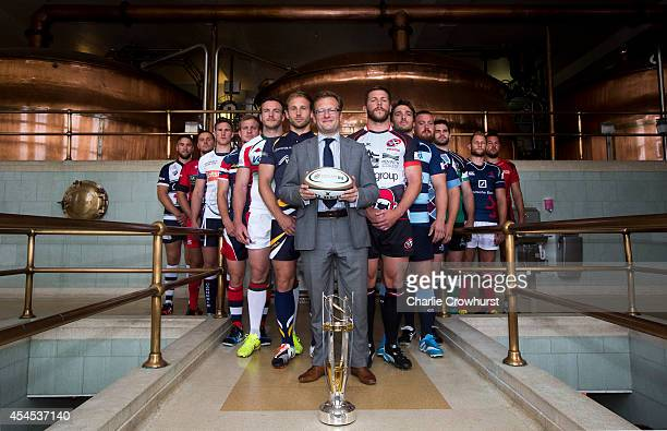 Captains from the championship teams pose for a photo with Marketing Director of Greene Kings Brewing and Brands Dom South during the 2014/15 Greene...