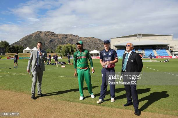 Captains Harry Brook of England and Mohammed Saif Hassan of Bangladesh take part in the coin toss ahead of the ICC U19 Cricket World Cup match...