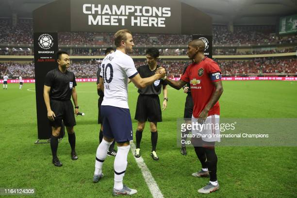 Captains Harry Kane of Tottenham Hotspur and Ashley Young of Manchester United shake hand prior to the International Champions Cup match between...