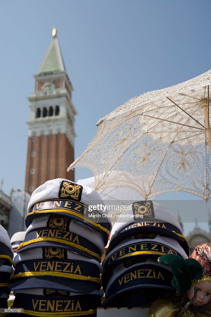 Captain's hats and sun umbrellas for sale in St. Mark's Square, Venice, Veneto, Italy, Europe : Stock Photo