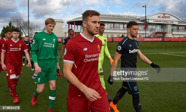 Captains Herbie Kane of Liverpool and Marcus Browne of West Ham United lead their teams onto the pitch at the start of the Liverpool v West Ham...